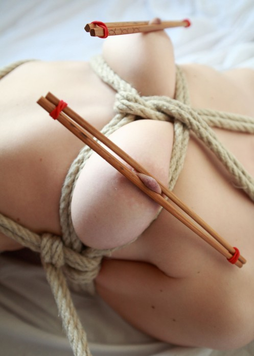 chopsticks on her bulging breasts. Great young tits