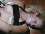 Strong clamps on her nipples. Her face covered in cum