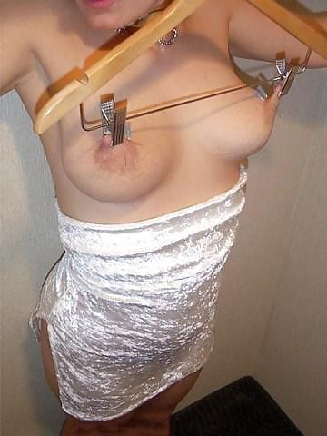 They pulled down her dress and hung her in the closet. By her nipples!