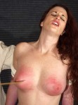 Her arms bound behind her and her breasts get caned over and over again